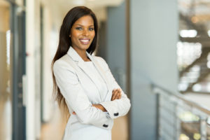 happy attractive african american businesswoman in office